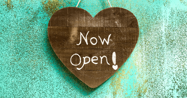 wooden heart that says now open